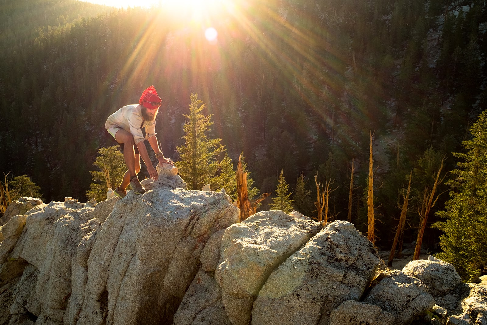 'Jamieson' climbing over boulders near camp and the sun begins to set.